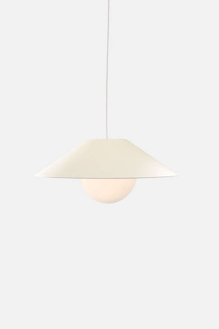 The largest size light, the Akoya , comes with a parchment shade instead of perforated metal and measures  inches wide by loading=