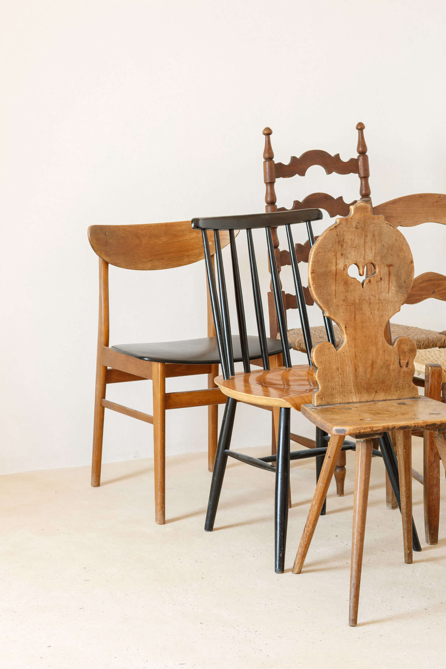The chairs throughout the house are a mix of styles: &#8