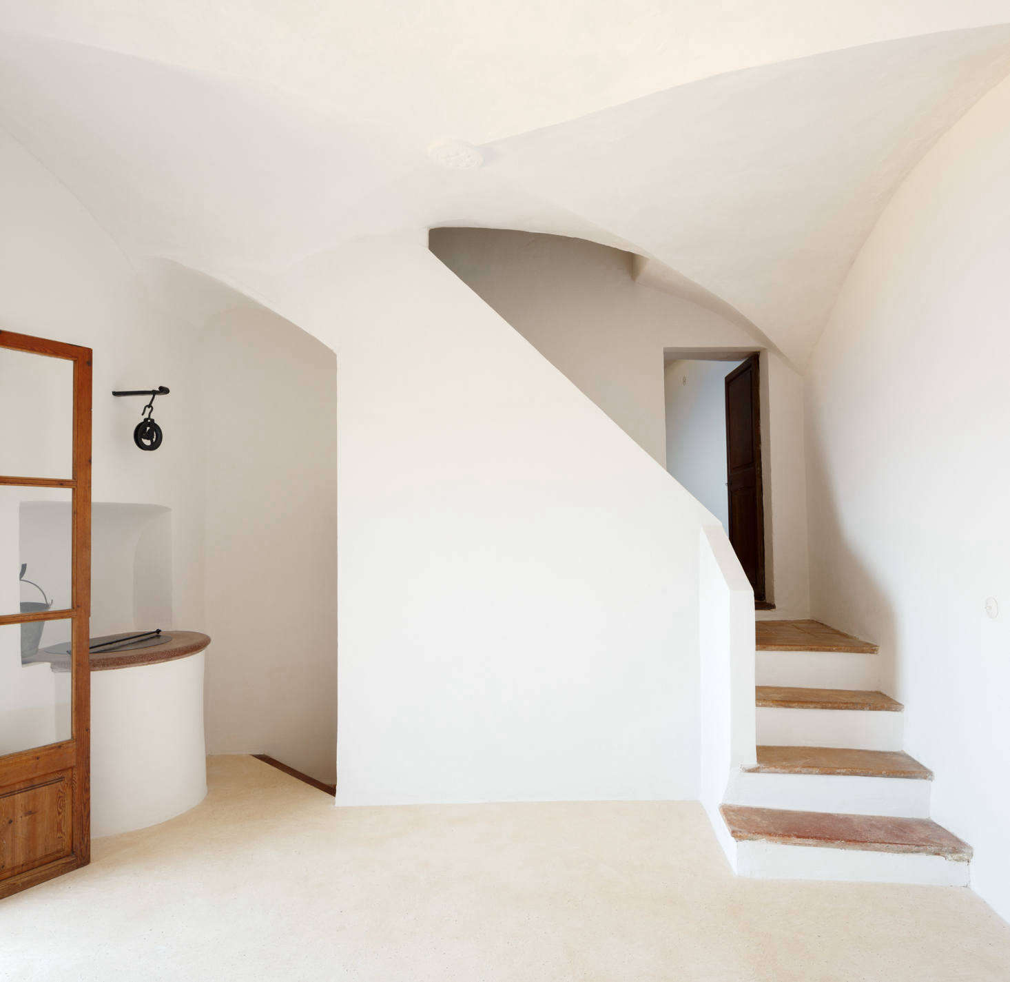 Two stairways lead to the other rooms: one bathroom, two bedrooms, a &#8