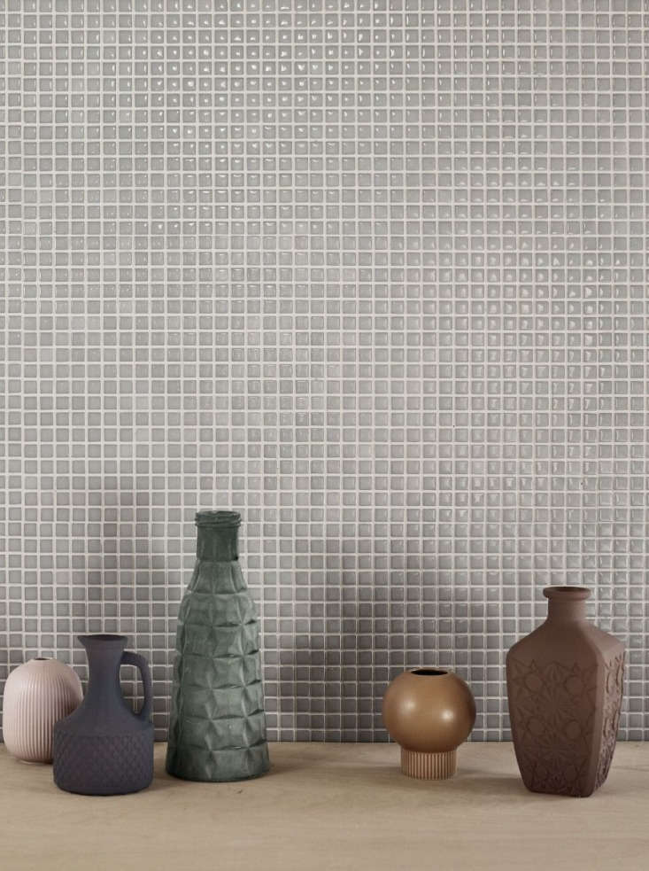 The Recycled glass mosaic Aura range has a high-gloss finish, available in light grayMist (shown), blue, and green, in two patterns—mosaic squares and mosaic bricks. The squares (shown) arrive as almost loading=
