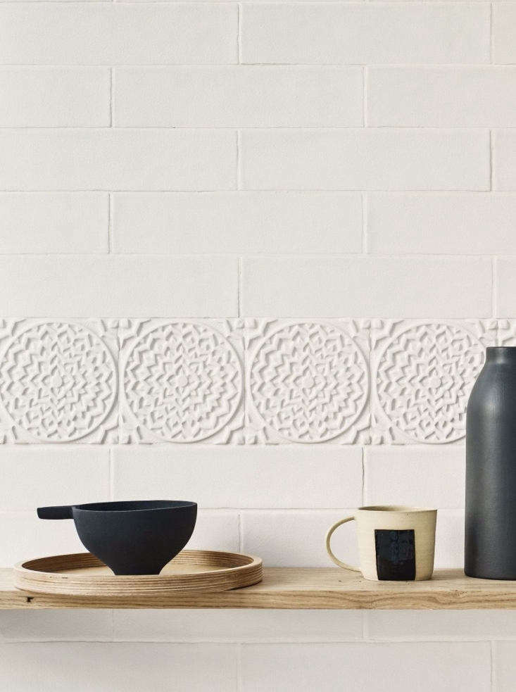 Japanese-inspired Osaka glazed ceramic tile has a subtle crackle glaze and a matte finish. It comesin two decorative squares, including the signature chrysanthemum shape shown here, plus two field tiles and two edge shapes. It&#8
