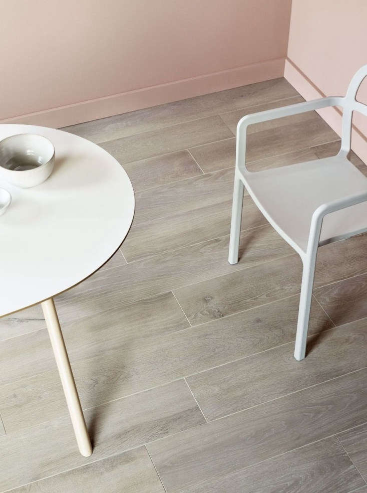 Lucerne tile is made of unglazed Italian porcelain, printed to resemble a wood pattern. It comes in four colors, including the light brown Meggen shown here, in long rectangles to resemble planks of wood. The 7.75-by-47-inch tiles shown here are £.6loading=