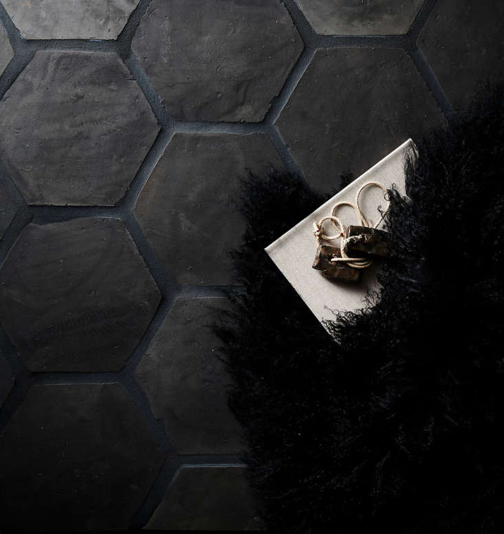 Eight-inch Hexagon tile installed as flooring, with dark charcoal grout.