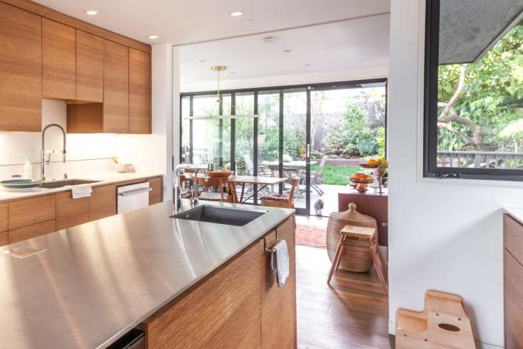 The kitchen island has a stainless steel countertop, which Prueitt would swap for marble next time: &#8