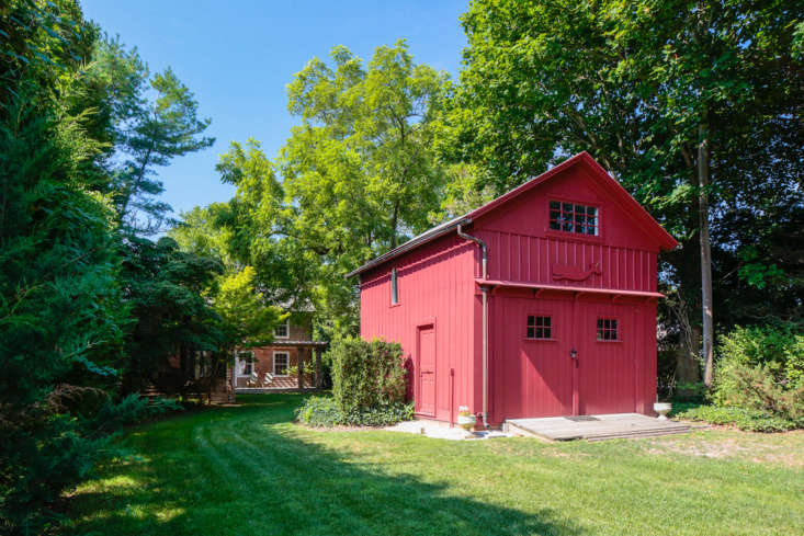 The red barn at the front of the house has extra beds for guests.