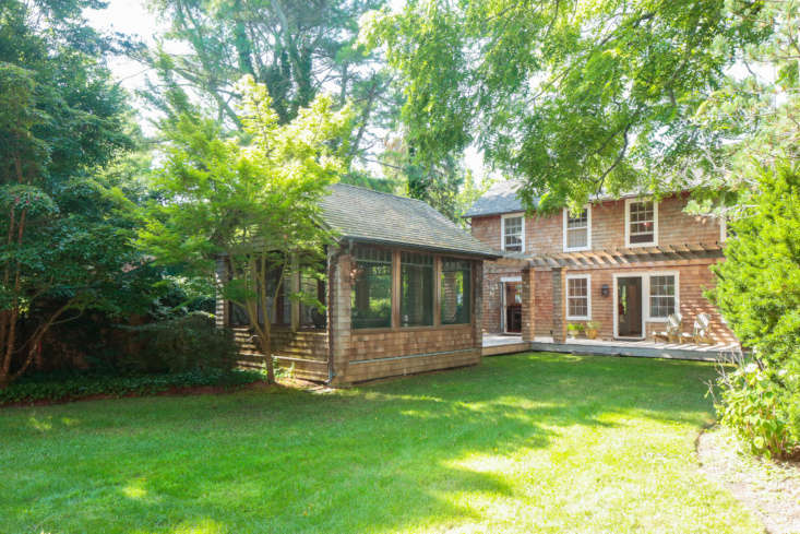 The cedar shingle-clad housedates from 50; the screened dining porch at left was added later.