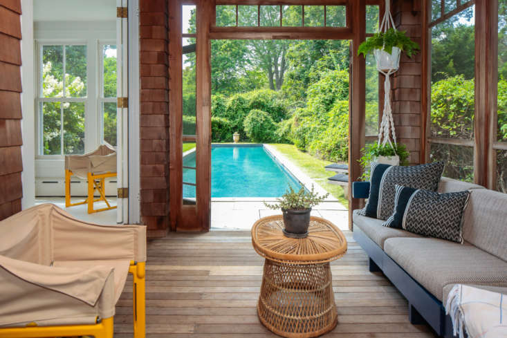 The sun porch opens onto the pool and back yard.