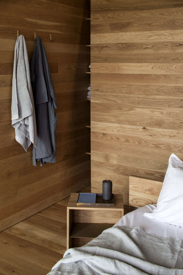 the wall paneling throughout the cottage is oiled oak. the king beds in the bed 14