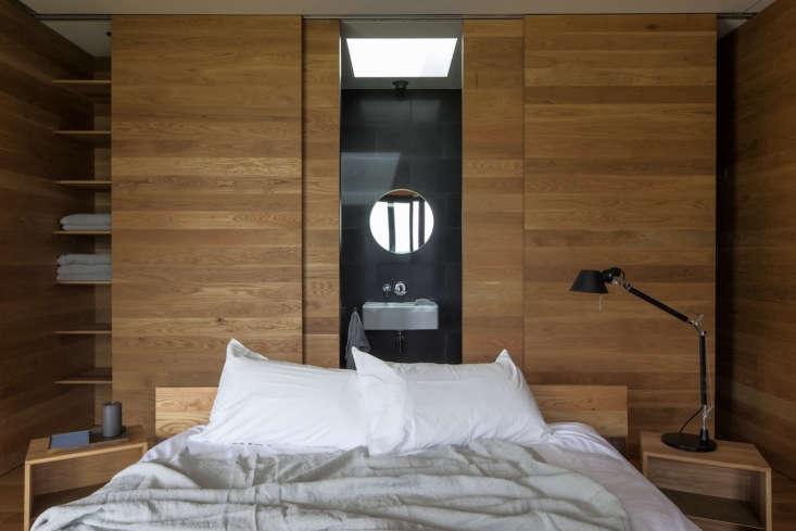 in both bedrooms, four oak panels behind the bed slide open to reveal the en su 13