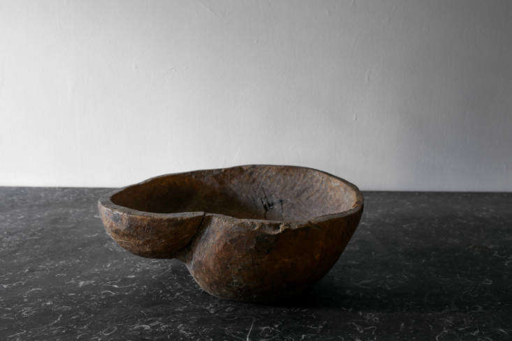 A variety of antique objects, like this hand-carved wooden bowl, are available at Galerie Half in Los Angeles.