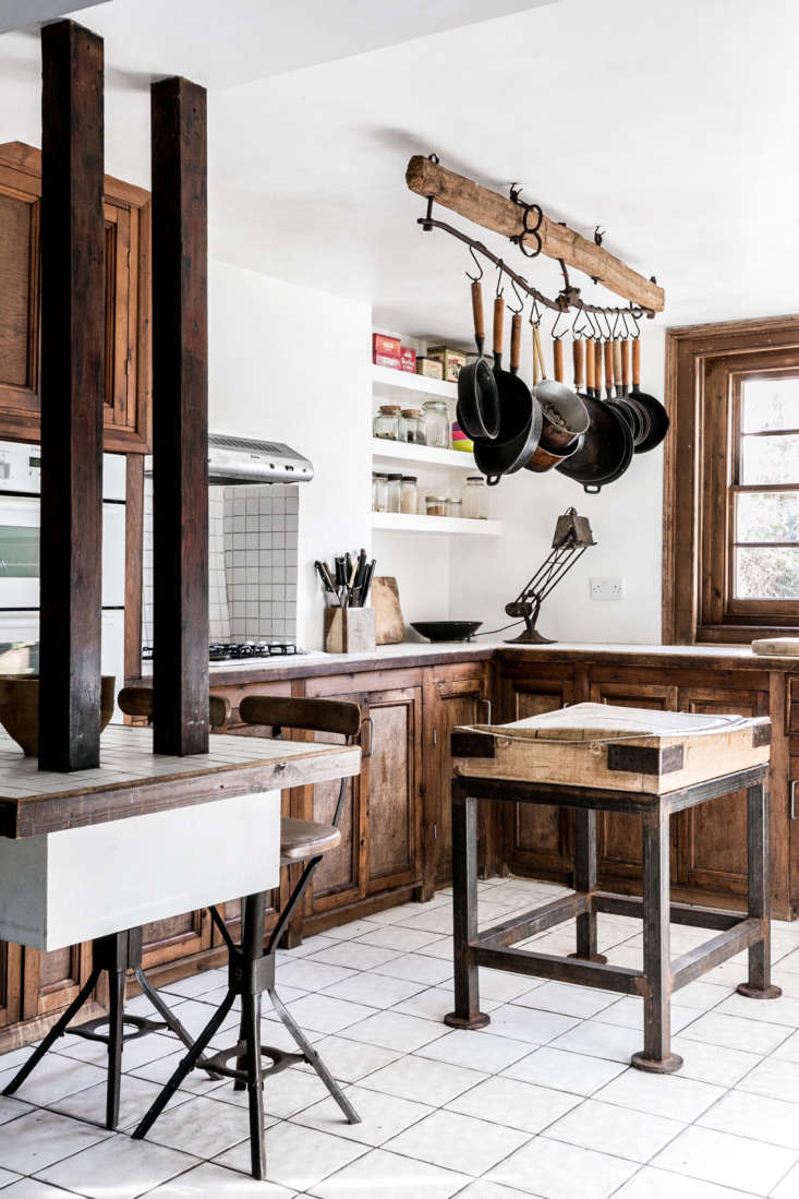 A hewn beam becomes a sophisticated pot rack inKitchen of the Week: Artist Graham Carter's Upcycled Hackney Kitchen.