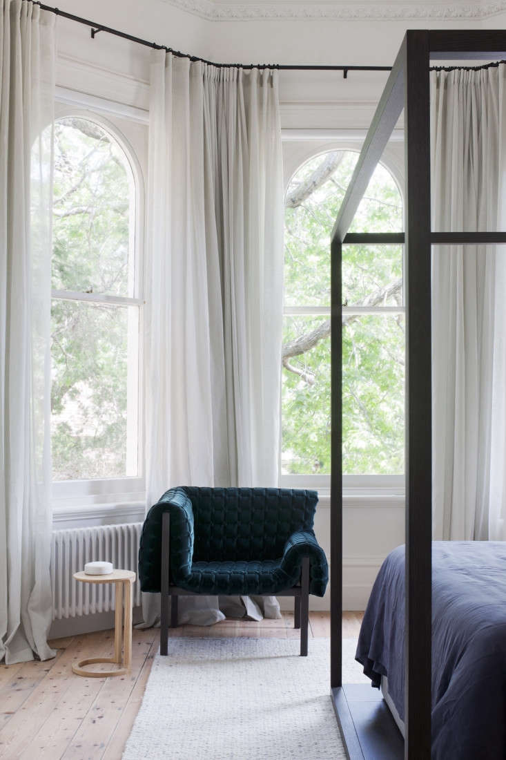 The four-poster bed in the master bedroom is by B&B Italia, and the Ruché chair is from Ligne Roset.