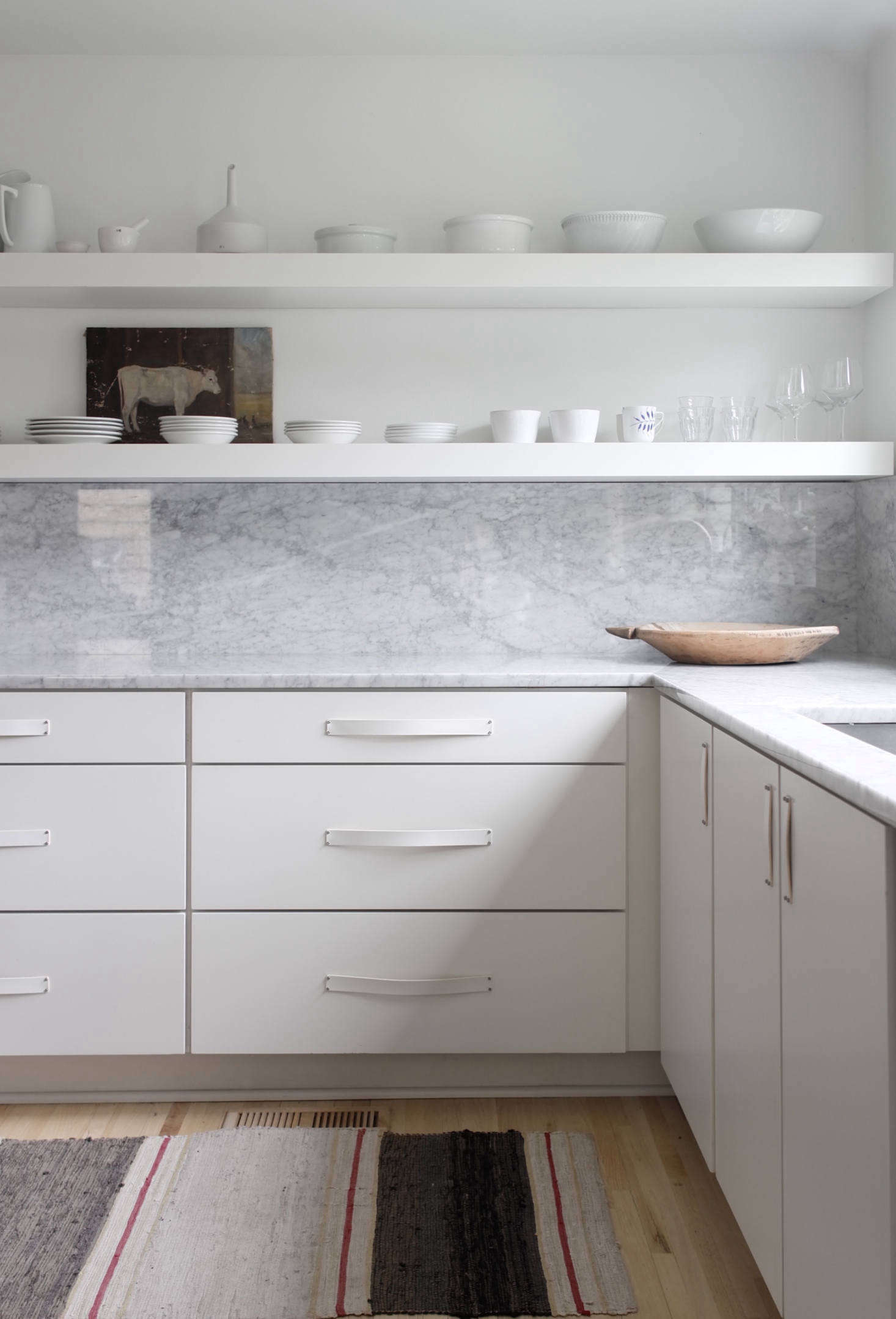 A detail of the kitchen drawers and open shelves, a schema that Izabella and Brandon designed themselves. Photograph by Izabella Simmons.