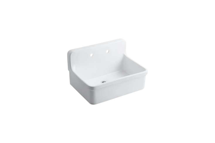 The kitchen sink is the Kohler Gilford Vitreous China Utility Sink in white; $694.69 at Home Depot.