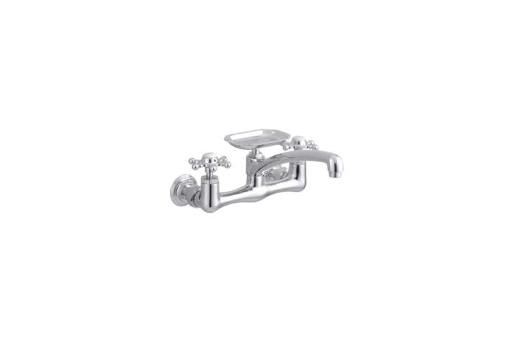 The Kohler Polished Chrome Wall-Mount Kitchen Faucet with Soap Dish is $896.59 at Faucet Direct.