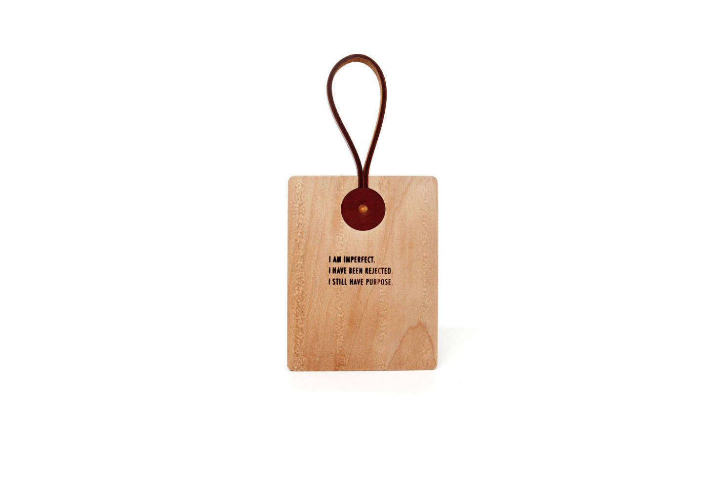 Izabella picked up an M. Crow Leather Strap Cutting Board on a trip to New York; $5