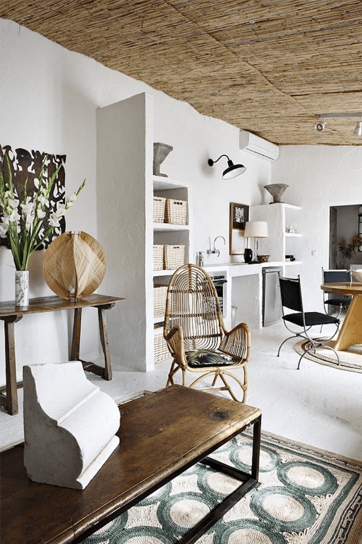 Spanish Eclectic An Airy Stable Turned Guest House on the Mediterranean Coast Castella and Flinn also wanted the young couple&#8\2\17;s guests to feel &#8\2\20;autonomous and at home on the Mediterranean sea.&#8\2\2\1; A crucial element: adding a kitchen. &#8\2\20;We designed everything,&#8\2\2\1; the designers say, building out stucco shelving and a simple stretch of counter along one wall. &#8\2\20;We brought in an antique marble sink to give that &#8\2\16;forever&#8\2\17; effect, while using state of the art appliances, like the stovetop and fridge,&#8\2\2\1; they say.