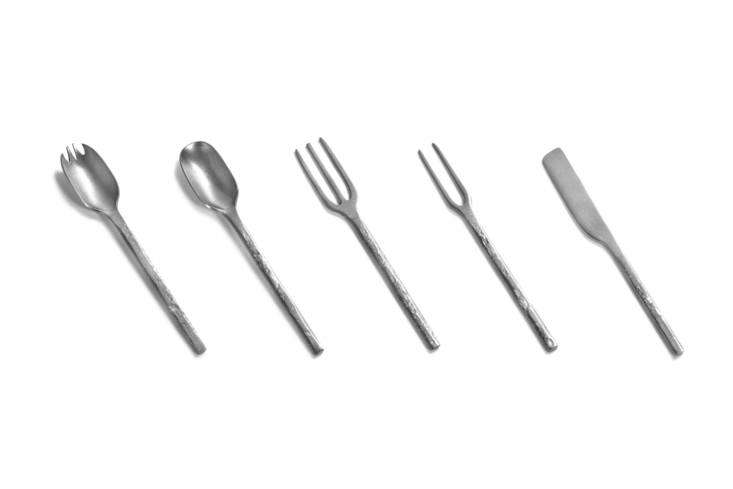 Designed by French shop Merci for Serax, the Stone Wash Flatware includes, from left, a spork, spoon, fork, picking fork, and spatula-like knife for €3 per piece at Merci.