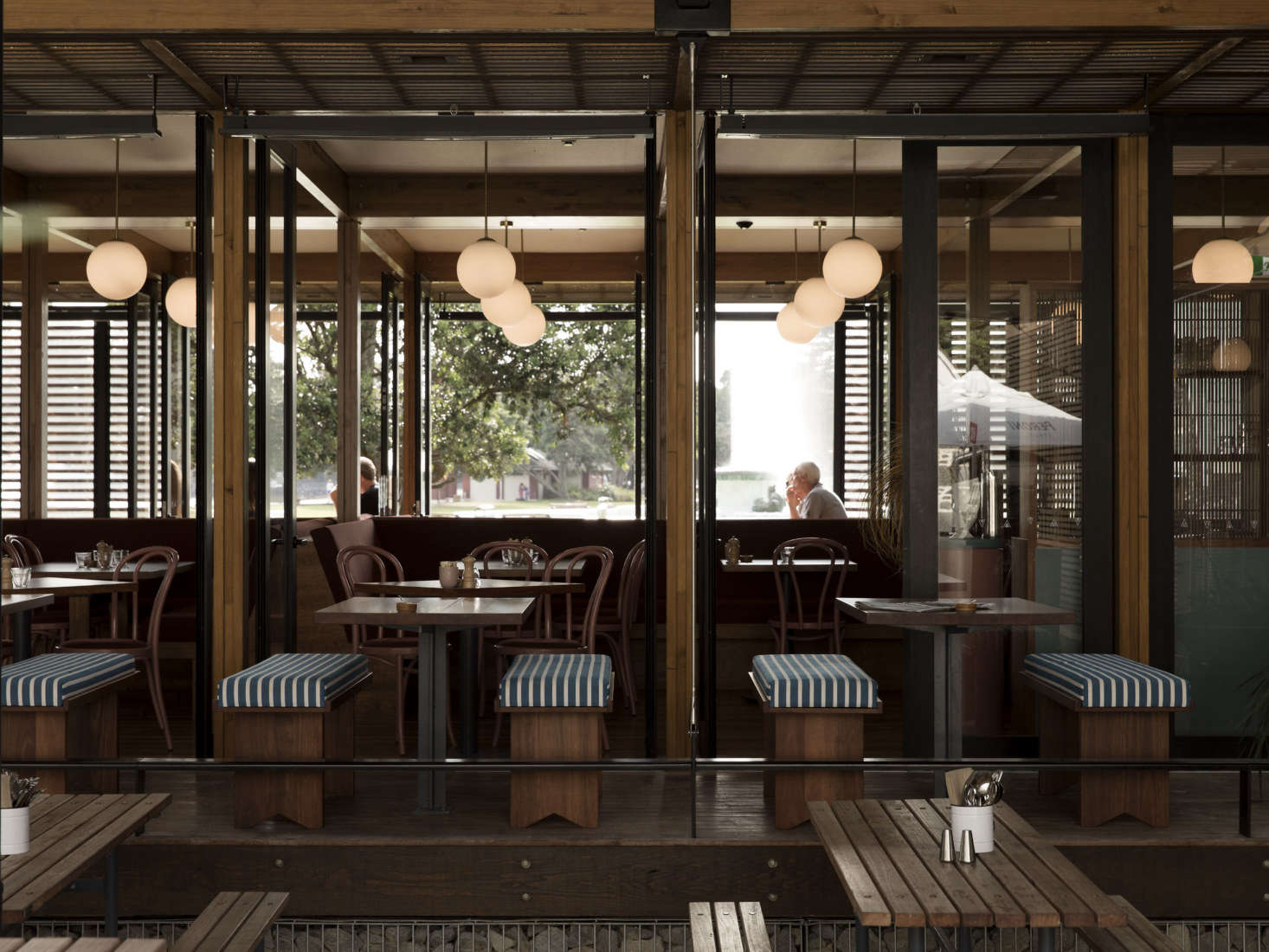 The pavilion windows open up in warmer months. The interior timber is Spotted Gum, facing beams are laminated pine, and the deck is Kwlia decking timber.