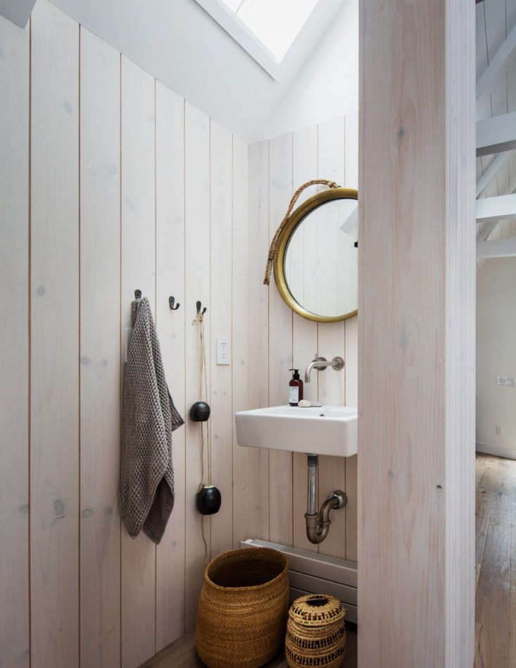 The upstairs powder room is whitewashed pine.