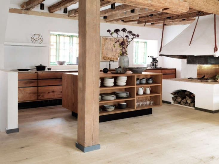 Chef couple Nadine Redzepi (author of Downtime: Deliciousness at Home) and René Redzepi (cofounder of the iconic Noma restaurant) designed their Copenhagen kitchen with functional storage, a giant woodstove, Electrolux appliances, and Garde Hvalsøe cabinetry.