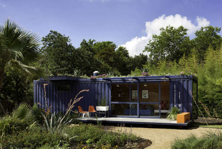 a guest house/garden retreat/playhouse made from a repurposed steel shipping co 15