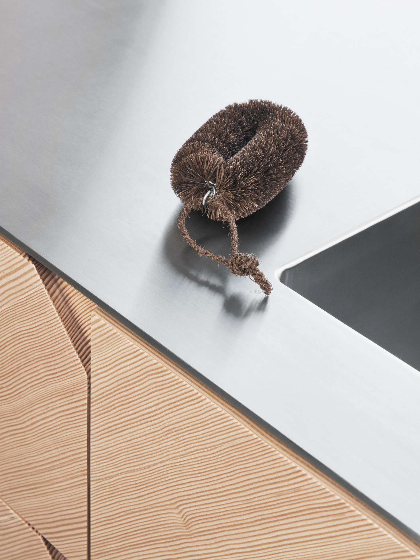 For the counter, Manz recommends applying a floating stainless steel counter, five or eight millimeters thick. The floating look is achieved by inserting strips of MDFthat are recessed from the edge. Reform offers the counter with a seamlessly welded Lavabo sink for $3,600. Solid wood, linoleum, laminate, and concrete countertops are also available.