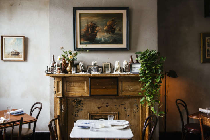 Seaworthy An 1832 Cottage Turned OldWorld Oyster Bar in New Orleans A favorite design detail: An original mantel is topped with candlesticks that are left to spill over with wax.