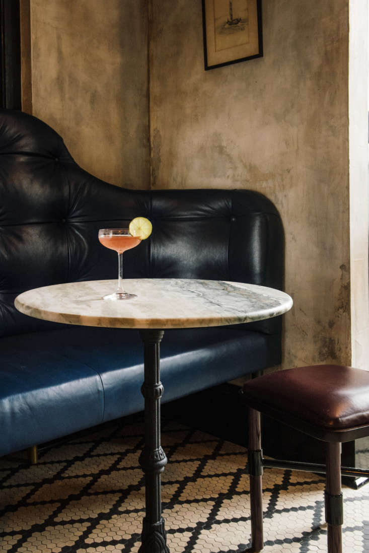 Seaworthy An 1832 Cottage Turned OldWorld Oyster Bar in New Orleans Along the opposite wall, marble topped tables and a handsome long settee that serves as a banquette.