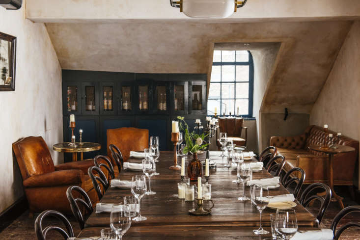 Seaworthy An 1832 Cottage Turned OldWorld Oyster Bar in New Orleans The private dining room on the third floor has a wall of darkly painted cabinets that hold liquor (note the imperfectly sloped ceiling) and sumptuous club chairs, giving the impression of a captain&#8\2\17;s cabin.