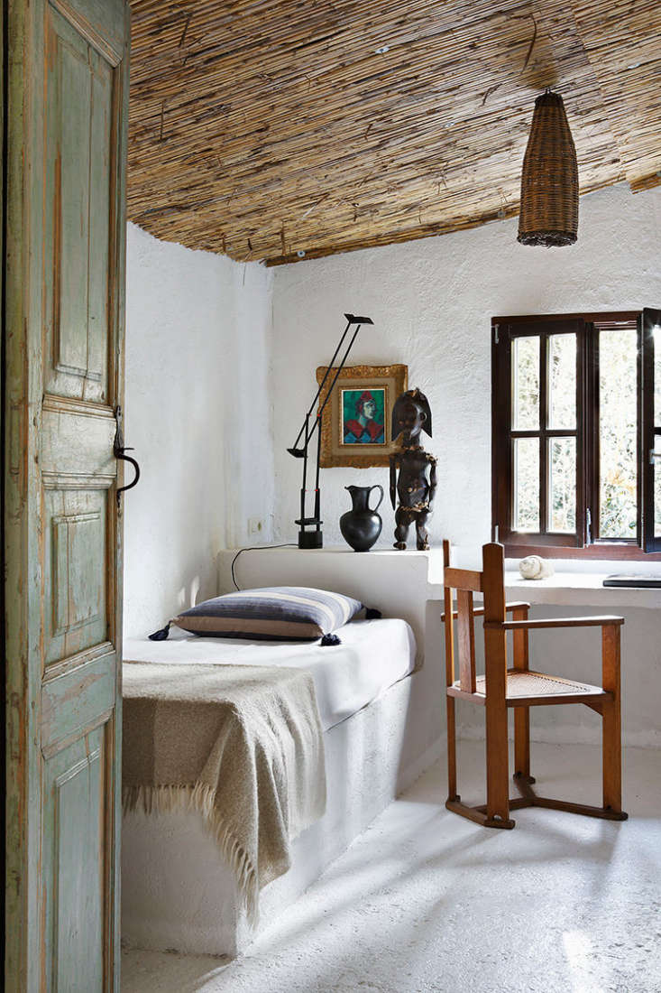 Spanish Eclectic An Airy Stable Turned Guest House on the Mediterranean Coast Beds are made simply, with light blankets and tasseled pillows.