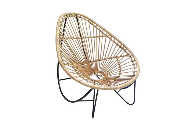 The ellipticArc Rattan Rocker is inspired by 50s styles; it can function as a rocking chair if you lean back; $400 at LeMay Shop.