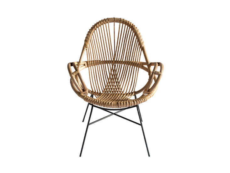 TheDiamond Rattan Chair has an iron base and is inspired by European designs from the 60s. It&#8