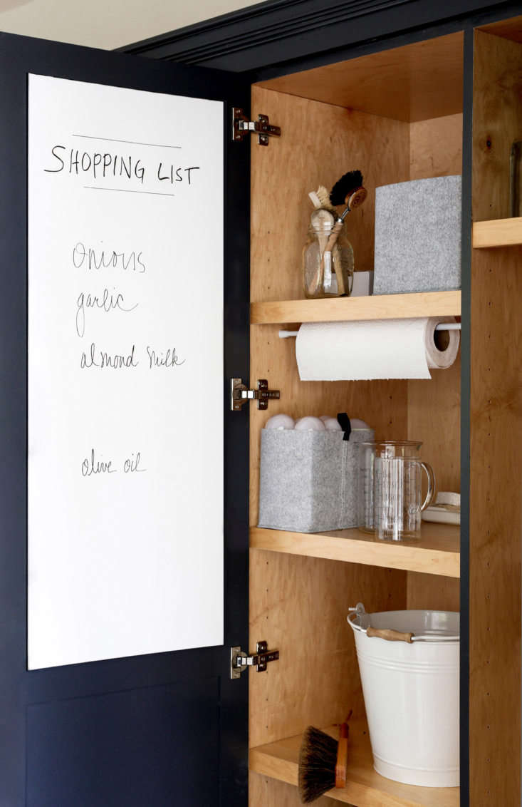 to create a custom whiteboard, michelle had a piece of plywood cut to fit insid 12