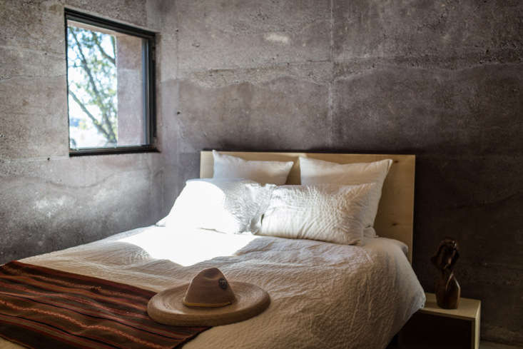 The Lavacrete that forms a bedroom wall is  inches thick, which helps to keep the house&#8