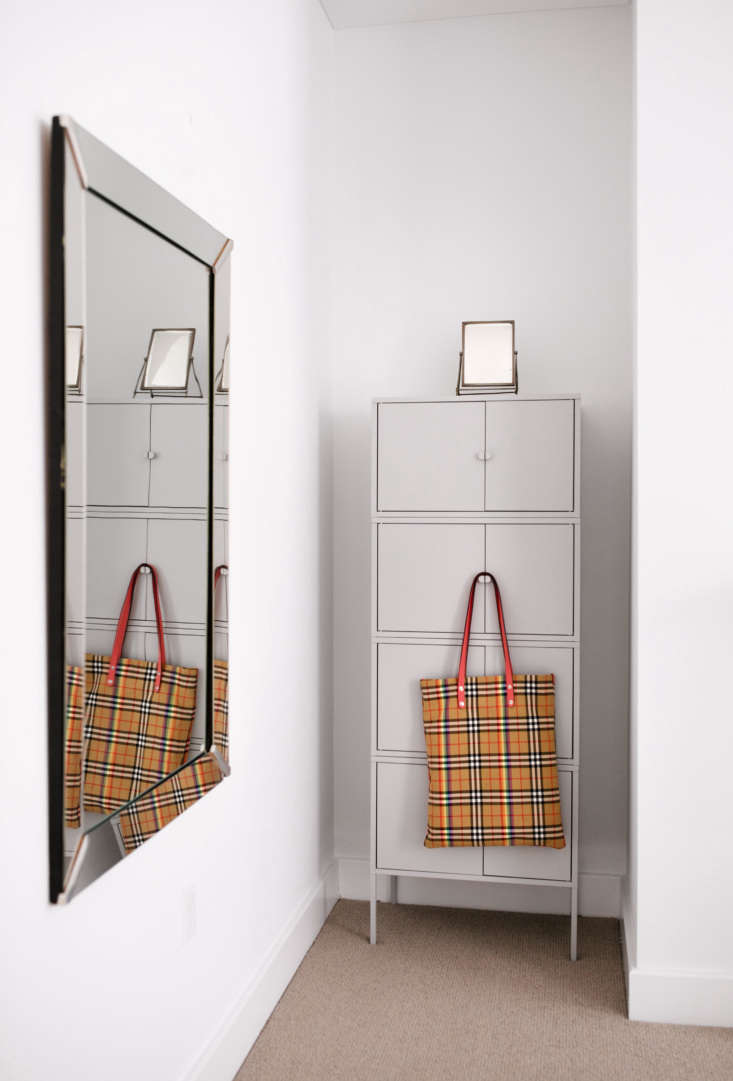 A mesh Burberry bag provides a dash of color.