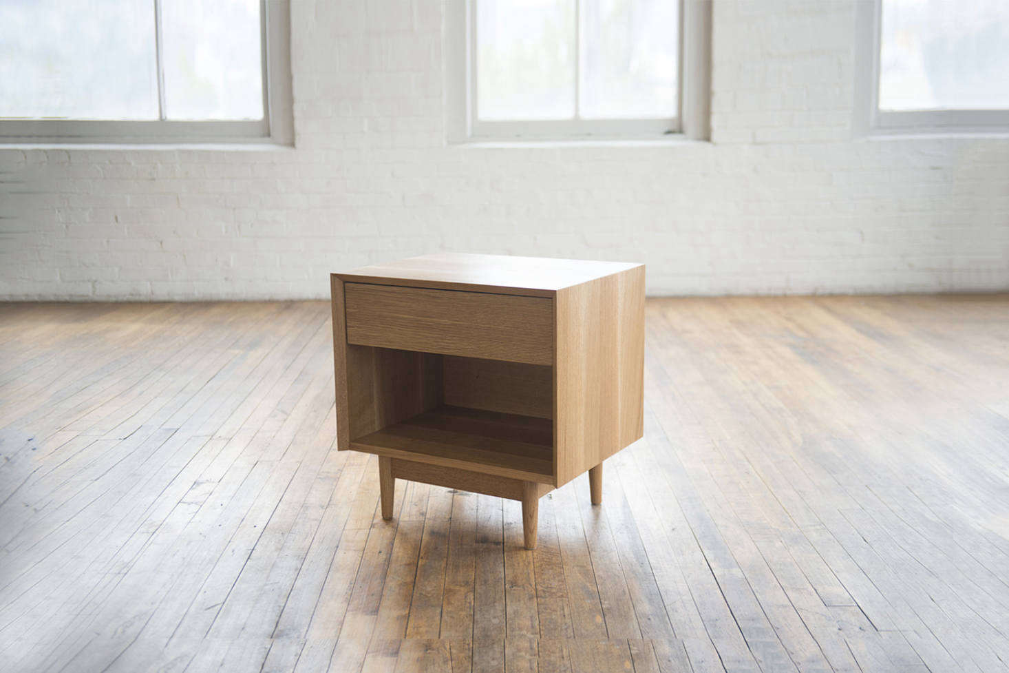 From Phloem Studio of Portland, Oregon, the Colleen Side Table is made from a range of domestic hardwoods: western curly maple (shown), ash, cherry, walnut, rift white oak, and western walnut. Each piece is crafted in the studio to order and requires a lead time of 8 to src=