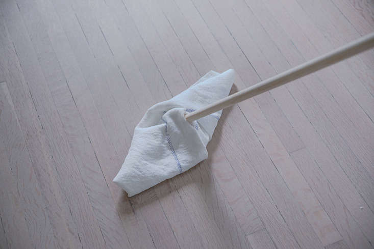 Then, lifting the mop head slightly, move the mop toward you just enough to capture the loose ends.