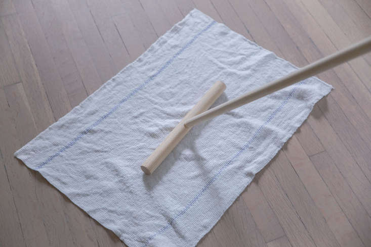 Place the mop head in the center of the wet rag or towel.