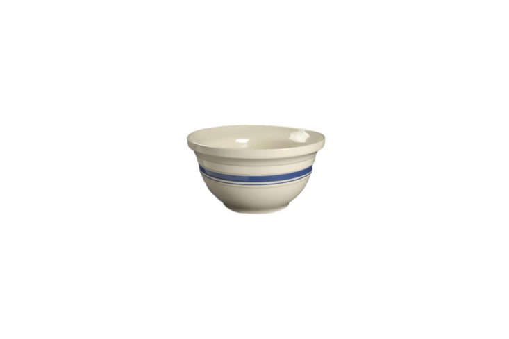 Source similar mixing bowls to those in the kitchen from Replacements. The vintage Friendship Blue Stripe 7-Inch Mixing Bowl is $5