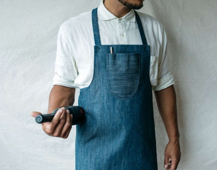 The GDSMinas Gerais Apron is made of 0 percent organic cotton denim, cut and sewn by hand in Oakland. It has a cotton rope tie (available in ivory or gray) that makes the apron adjustable for all sizes; $8.