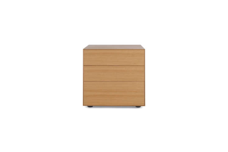 Designed by Ibon Arrizabalaga, the Lauki Bedside Table is available in oak (shown), walnut, graphite, and white; $795, exclusive to Design Within Reach.