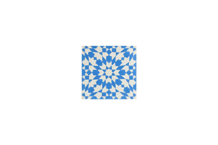 The floors are designed with Blue and White Eight Point Star Tile from Imports from Marrakesh; $loading=