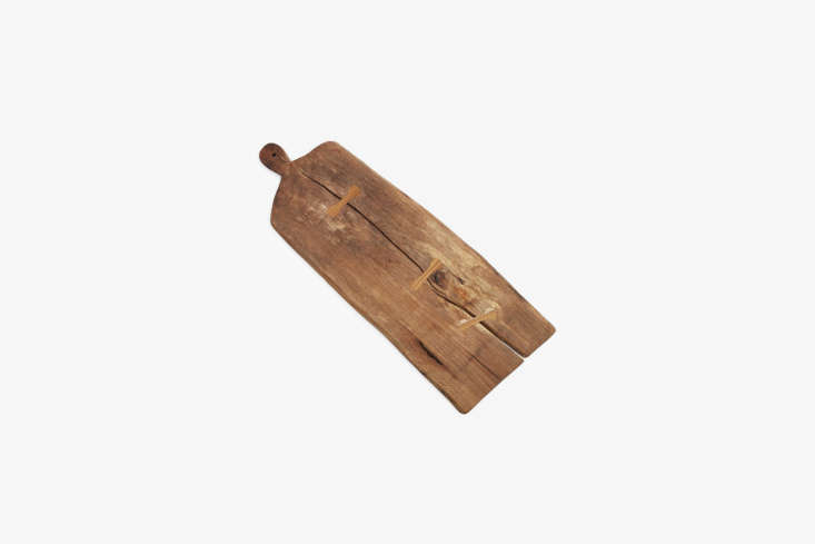 The Large Thick Cutting Board, hand-carved from fallen wood in Mexico for ABC Carpet & Home, is $0.