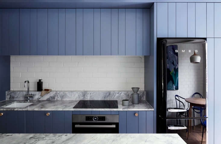 The kitchen cabinets are MDF with custom routed lines for the paneled wood effect. &#8