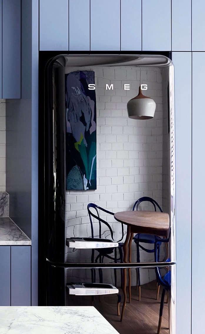 A glossy black Smeg refrigerator has the narrow profile Breeze wanted.