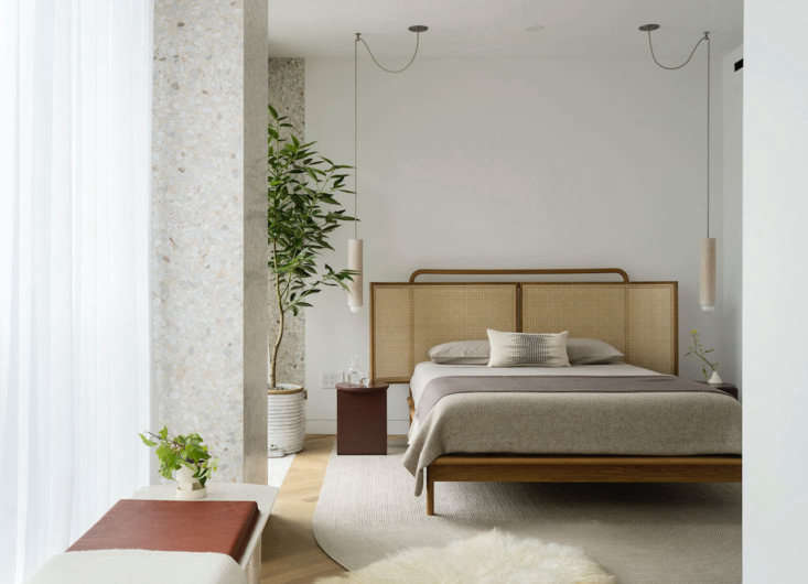 Material Interiors A Shoppable Apartment in New York Design Luminaries Edition New items from Workstead are also on view. In the bedroom: theMae Bed with a caned headboard from the Radnor Made line, and two bleached maple Tower Pendants by Workstead.