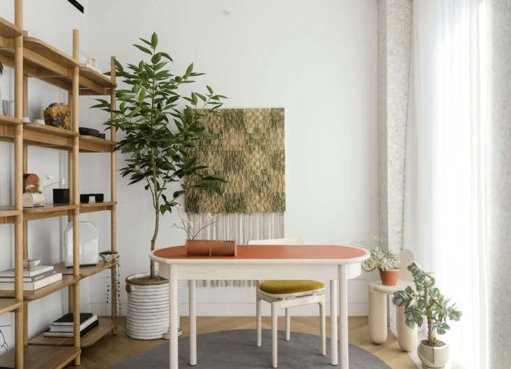 Material Interiors A Shoppable Apartment in New York Design Luminaries Edition An artful home office is fitted with more from the Radnor Made collection: aMae Desk with a tanned leather top, Mae Shelving, and an upholstered Pillar Dining Chair by Bunn Studio.