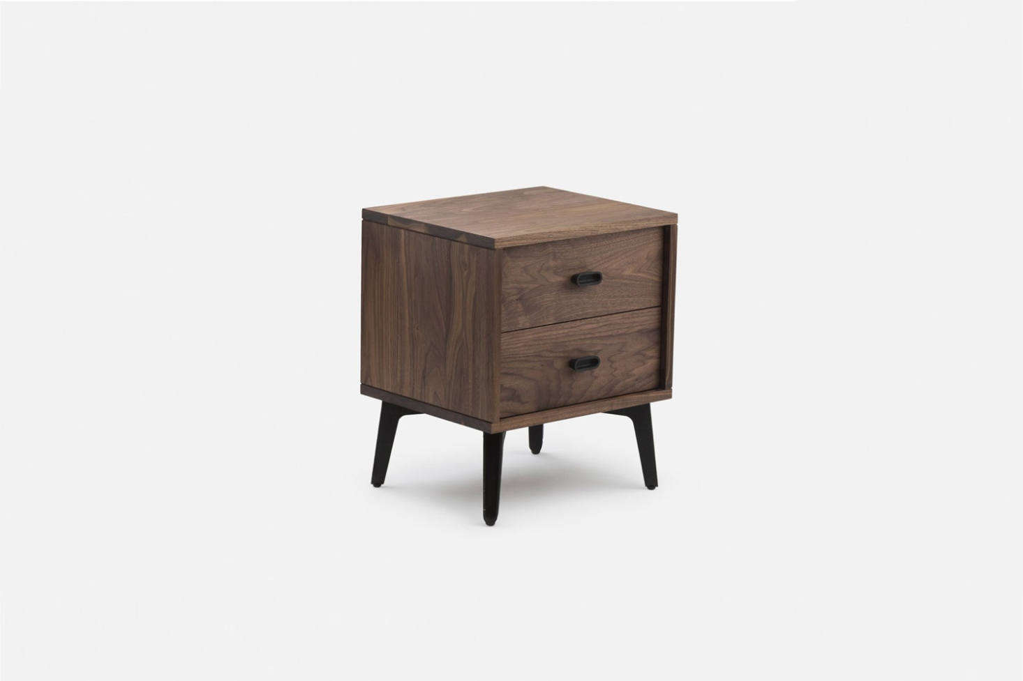 Designed by Matthew Hilton for De La Espada, theMcQueen Bedside Chest has two drawers (withsoft-closing piston action), dovetail joinery, and cast iron handles. Available in Danish-oiled walnut. Contact De La Espada for more information.