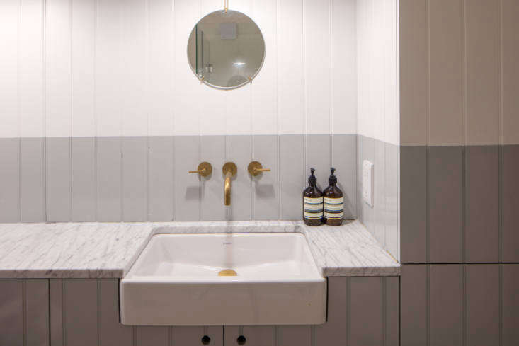 Kitchen of the Week A GreatestHits Kitchen for a DanishAmerican Couple in London A bathroom is small but luxe with a marble counter. It&#8\2\17;s half painted in Pure Grey \2 from Papers & Paints.